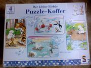 Puzzle Koffer Der