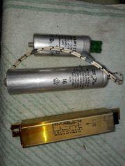 Vorschaltgeräte und Kondensatoren