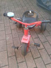 Dreirad rot zu