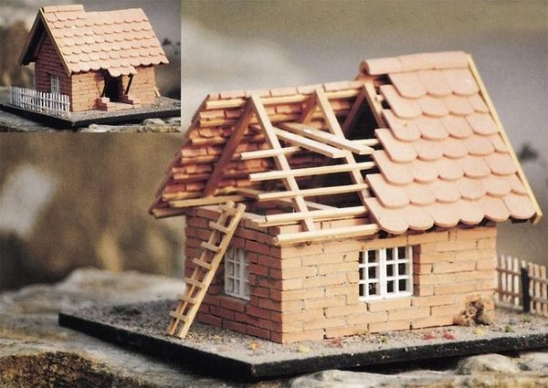 modellbauhaus aus naturziegelsteinen mit holzlattung. Black Bedroom Furniture Sets. Home Design Ideas