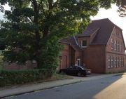 Mehrfamilienhaus mit Büro-/