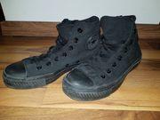 Schwarze Converse Chucks High Größe