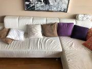 Wohnzimmercouch weiß Leder