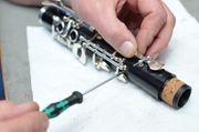 Reparatur-Service für Saxophone Klarinetten Querflöten