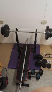 Hantelbank mit Gewichten
