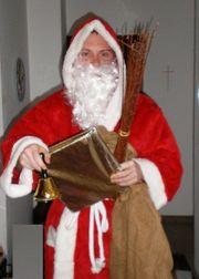 Nikolaus Weihnachtsmann Pelzmärtel besucht Familien