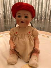 Antike Puppe, Marke